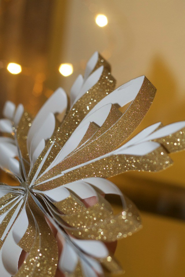 $1 Sparkly Snowflake Paper Ornament from ABCs & Garden Peas